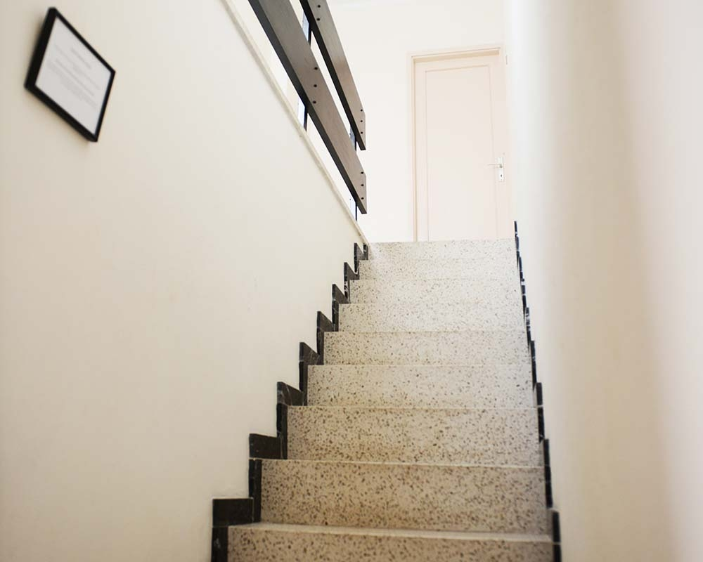 Stair leading up to the office and roof terrace
